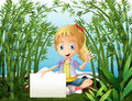 A rainforest with a young girl holding an empty signage illustration of Royalty Free Stock Images