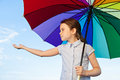 Is it raining little girl standing underneath an umbrella she holding her right hand stretched out she wants to see whether still Royalty Free Stock Photography