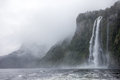 Rainny and foggy day at milfordsound waterfall in a Stock Photography