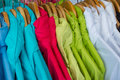 Rainproof jackets in bright colors on a rack for sale Royalty Free Stock Photos