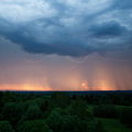 Rainstorm lightning and sunset at the same time Royalty Free Stock Photography