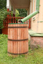 Rainwater barrel old near house russia Royalty Free Stock Photography