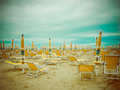Rainy beach season empty scenery with deckchairs and umbrellas Stock Image