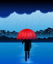 Rainy day man with red umbrella in the rain Royalty Free Stock Image