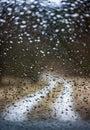 rainy day, rain drops on a car window Royalty Free Stock Photo