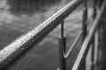 Rainy day water drops on metal handrails Royalty Free Stock Photos