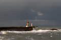 Rainy mornings sun and rain over the north portuguese coast seeing pier lighthouse and beacon of the entry of douro river porto Royalty Free Stock Image