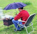 Rainy situation. Protection brazier from rain. Royalty Free Stock Photo