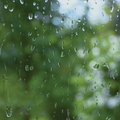 Rainy summer day, raindrops on window glass, large detailed macro closeup, gentle bokeh Royalty Free Stock Photo