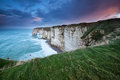 Rainy sunrise over cliffs in atlantic ocean etretat france Royalty Free Stock Photo