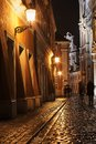 Rainy walk the cobbled street at night Royalty Free Stock Photo