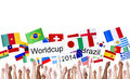 Raised arms holding nation s flag for world cup many and banners in brazil Stock Image