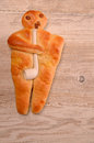 Raisin bread man raising on a rustic wooden background Stock Image