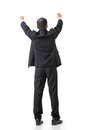 Raising hand to put something rear view of asian business man over his head full length isolated on white Royalty Free Stock Photography