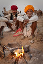 Rajastani men baking chapati Stock Photos