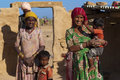 Rajasthani family rajasthan india – feb in front of their mud hut on february in jaisalmer india there are many tribes in Royalty Free Stock Image
