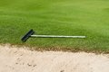 Rake for spreading the sand in golf course Stock Image
