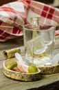 Rakija cucumber olives and bacon Royalty Free Stock Photo