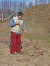 Raking old grass senior man in garden Royalty Free Stock Images
