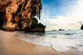 Raliegh beach in thailand with limestone rock at sunset Stock Images