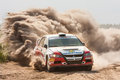 Rally car on gravel special stage Stock Images