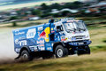 Rally KAMAZ truck rides a dusty road Royalty Free Stock Photo