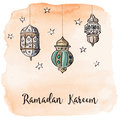 Ramadan Arabic lanterns with orange watercolor background. Royalty Free Stock Photo
