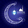 Ramadan mubarak - hanging lamps on moon and masjid on blue background vector design
