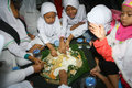 Ramadhan islamic school students eat after fasting in the month of ramadan in the town of solo central java indonesia Stock Photo
