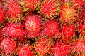 Rambutan fruits at local market Stock Photos