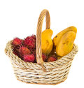 Rambutan and mango fruits ii in a basket over white background Stock Photos