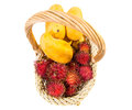 Rambutan and mango fruits iv in a basket over white background Stock Photography