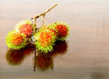 Rambutan on wooden table group of Stock Images
