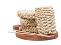 Ramen instant raw noodles on wooden plank with chopsticks general view Stock Image