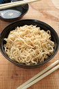 Ramen noodles in a lacquer bowl with chopsticks Stock Photo