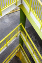 Ramp with several floors. Yellow railing.