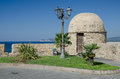 Rampart in alghero town sardinia italy picture of at waterfront with streetlamp and caccia cape the background Royalty Free Stock Photos