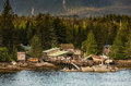 Ramshackle boat salvage businesses near ketchikan rustic and storage on alaskan inner passage Royalty Free Stock Photo