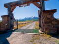 Ranch entrance gate of the last dollar in autumn with a view of the dallas divide on the back Stock Photos