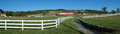 Ranch fence panorama panoramic view of with white wooden rail border mountains of northeast pennsylvania Royalty Free Stock Photo