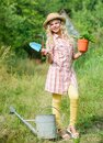 Ranch girl. Happy childhood. Planting plants. Little kid hold flower pot. Spring country works. Happy childrens day Royalty Free Stock Photo