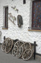 Ranch house detail of decoration cartwheels and working horse equipment as country Stock Images