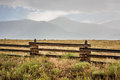 Ranch land below the sangre de cristo mountains with fence in foreground in valley in central colorado on a rainy day Stock Photo