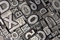 Random arrangement of letterpress lead letters Royalty Free Stock Photo