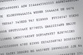 Random codes code printed on white paper shot from above Stock Photography