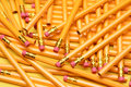 A random pile of pencils brand new scattered on yellow surface great for back to school projects Stock Photography