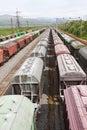 Range of multicoloured rail road waggons Royalty Free Stock Photo