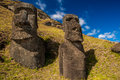 Rano raraku two buried moais one with pictograph symbols at quarry on rapa nui Stock Photo