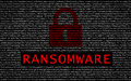 Ransomware text with red lock over encrypted text Royalty Free Stock Photo