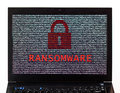 Ransomware text with red lock over encrypted text on a laptop sc Royalty Free Stock Photo